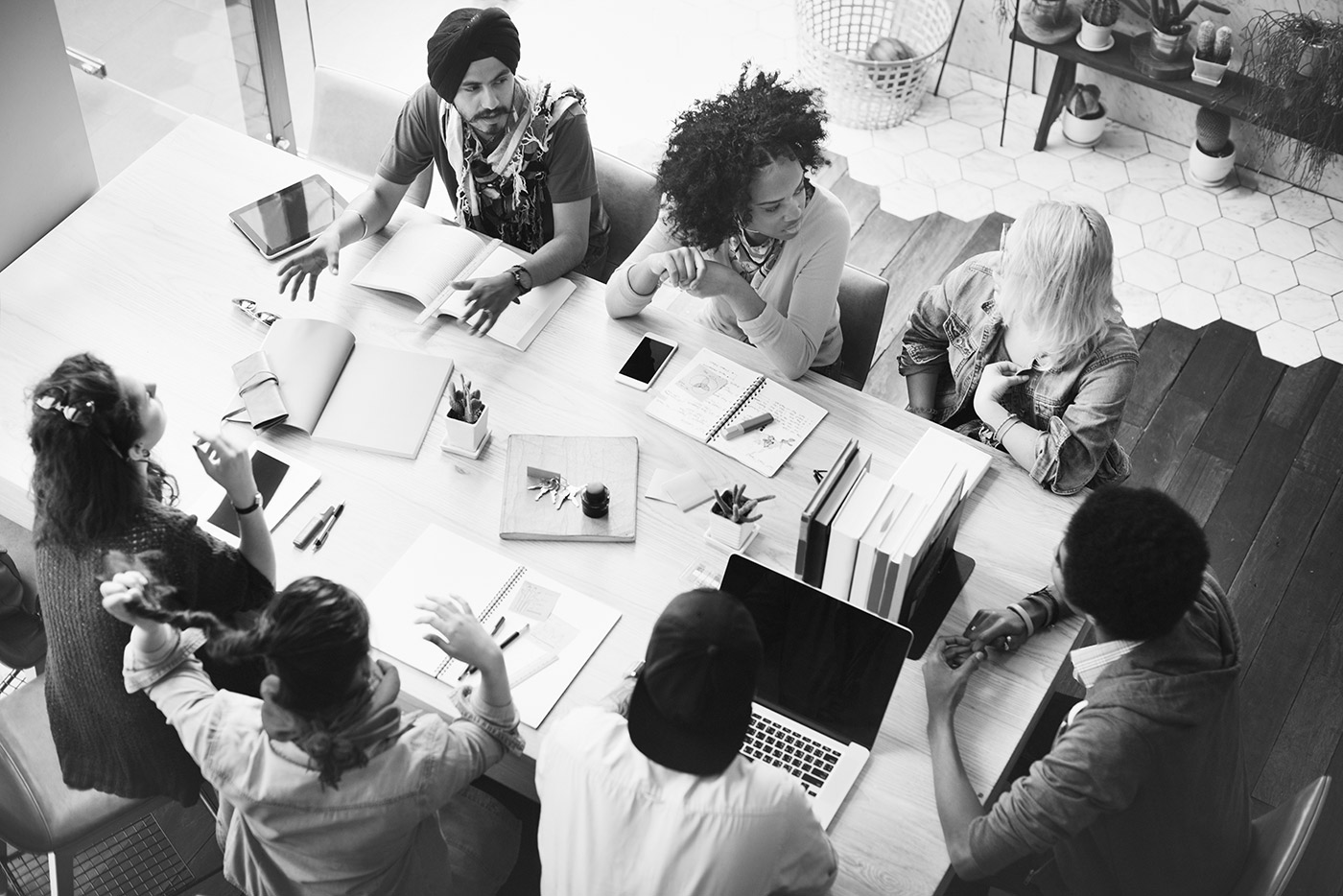 a group of people talking at a table